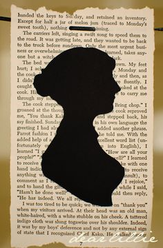 Jane Austen... the page behind her is not her writing. Not sure if I should feel indignant or grateful that some other page was irreverantly ripped from its binding.
