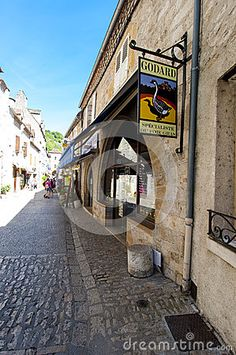 Photo about Foie gras shop at Rocamadour a commune in the Lot department in south-western France. Image of religious, buildings, quercy - 38659784 Rocamadour France, Foie Gras, City Streets, Paths, Vectors, Sidewalk, Boat, Sky, Stock Photos