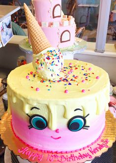 Lively Pink And Yellow Birthday Cake With A Creative Face That Brings Personality To It