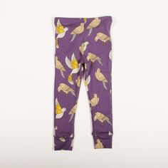 These quirky leggings are bright purple, and feature an all-over pattern of doves.The leggings have an elasticated waist and cuffs at the ankle.10...
