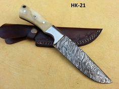Damascus Hunting Knife HK-21  Open Length: 10 Inches Blade Length: 5.5 Inches Handle Length: 4.5 Inches Price: $90USD Handle made camel bone with Mosaic pin  FREE SHIPPING