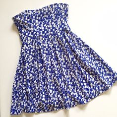 """Urban Outfitters floral strapless dress Adorable fit and flare dress by Cooperative. Blue and white textured fabric, lined, stretchy. Measures 16.5"""" across bust unstretched and 27"""" long. Excellent condition, no holes or stains. Bundle and save 20%! Urban Outfitters Dresses Mini"""
