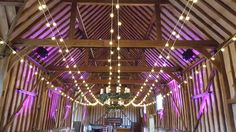 Ungathered festoon canopy the length of The Great Barn with warm welcoming uplighting  #festoon #wedding #barnweddings #uplighting #berkshire @lillibrooke