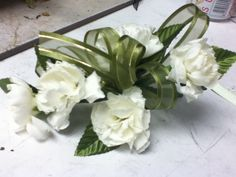 Spice up a carnation corsage with a glitzy ribbon!