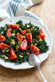 Cavolo Nero Salad With Tomatoes and Fried Garlic Oil - paleo, vegan, vegetarian, mostly raw, gluten free, nut free, egg free. Recipe here: http://eatdrinkpaleo.com.au/cavolo-nero-salad-recipe-with-tomatoes-fried-garlic/ - Kale Salad