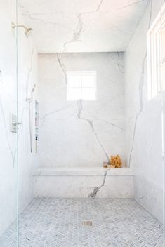 Walk into a large master bathroom shower to admire thin gray marble herringbone floor tiles and marble slab walls featuring stacked shower niches and a marble shower bench. Source by Master Bathroom Shower, Shower Niche, Modern Bathroom, Small Bathroom, Bathroom Showers, Bathroom Ideas, Shower Ideas, Cultured Marble Shower Walls, Carrara Marble Bathroom