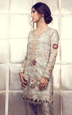 This high neck long anarkali suit is in purple color silk. Each kali of this anarkali suit is of different designer silk fabric. Sleeves and dupatta of this anarkali suit is in Pink color which gives Pakistani Formal Dresses, Indian Dresses, Indian Outfits, Emo Outfits, Modest Outfits, Pakistani Designer Suits, Pakistani Suits, Pakistani Clothing, Designer Anarkali
