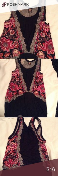 Free People Floral Accent tank Black with a floral print that looks like a vest size XS Free People Tops Tank Tops