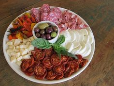 How to antipasto platter. I love all things about an antipasto. There are too many good things all in one place. Onion Recipes, Great Recipes, Favorite Recipes, Appetizer Recipes, Appetizers, Snack Recipes, Snacks, Antipasto Plate, Reception Food