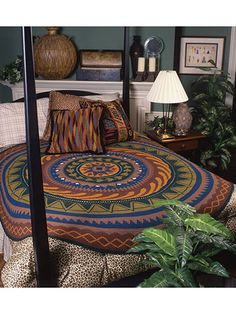 "The southwest styling of this anything-but-ordinary creation would make it a beautiful rug too. Made with sport weight yarn.  Finished size is approximately 78"" diameter."