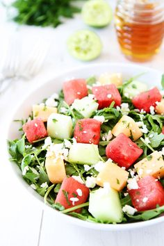Melon Arugula Salad with Honey Lime Dressing Recipe on twopeasandtheirpod.com Love this refreshing summer salad! #salad #glutenfree