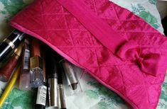Pretty in Pink DIY Makeup Bag - This Pretty in Pink DIY Makeup Bag is easy to make and adorable too! Of course it's great for keeping makeup organized, but you can also take it out to parties as a clutch. Learn how to sew a pouch for your makeup with this free sewing pattern, which will help you create a soft, quilted pink bag with a lavender lining and polka-dotted pockets to keep you organized. If you're looking for a pouch pattern, this very feminine bag may be just what you're looking for.