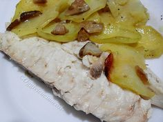 Baked bream with porcini mushrooms on a bed of potatoes
