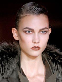 Sleek Hair + Metallic lips and sculpted hair at Hakaan via allure.com