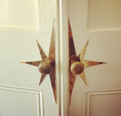 vintage brass hardware; star door handles