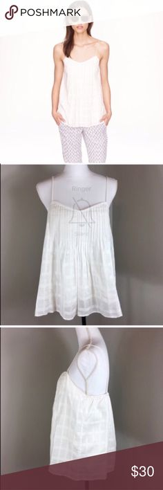 J.Crew Pintucked Cami J.Crew Pintucked Cami in white. Size 8. Approximate measurements flat laid are 26' long and 17' bust. Pre-owned condition. This is more of an off white than stark white. 😂🤦🏻♀️🙈 Sorry for the mess up on my screen shot photo. J. Crew Tops Tank Tops