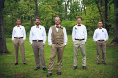 Casual groomsmen in khakis  white shirts. From a completely handmade, DIY backyard wedding in the Blue Ridge Mountains. Images by BMW Photography.
