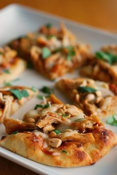 Chicken, peanut sauce, and mozzarella baked on top of naan bread until the cheese is melty and delicious.