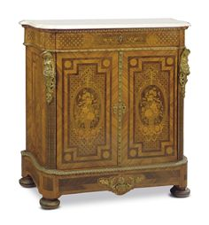 A NAPOLEON III ORMOLU-MOUNTED BOIS SATINE AND MARQUETRY SIDE CABINET -  THIRD QUARTER 19TH CENTURY