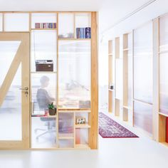 MFRMGR creates semi-transparent cubicles for sound production office in Warsaw