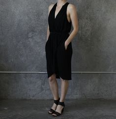 Black rayon Journey dress with beautiful draped fit, side slip pockets and teardrop cutout opening in back. This item in on back order please email us with request!