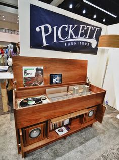 This retro-styled beauty surprised me as I turned the corner while making the rounds, as I immediately recognized the aesthetic audiophile style from a recent preview post. Pickett Furniture's custom creation is even more beautiful in person than the sneak peak photos hinted...