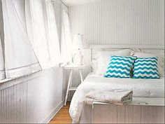 Coastal bedroom - love the white walls and linen / drapes with open windows, simple side table and pops of aqua colour for a modern, fresh beach cottage nautical coastal style    #coastal