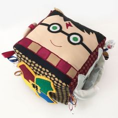 Create a Harry Potter-themed baby toy for your little one. Each side offers a different sensory activity. Free pattern and tutorial!