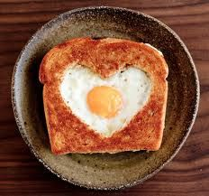 This was one of my FAVORITE breakfasts that my Mom made for me. She called it egg in a hole, but I've heard it called egg in a basket, toad in a hole, and popeyes. What ever you call it, I love it still.