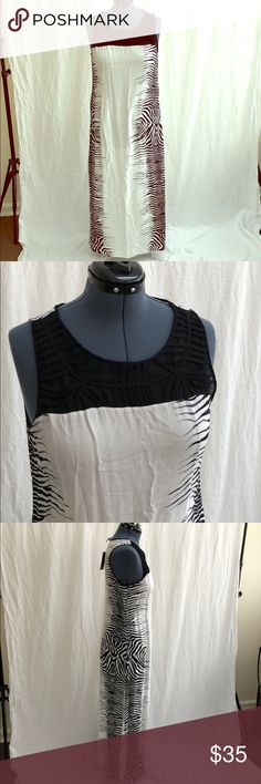 Zebra Print Lattice Neck Maxi Katie's Dress Size16 This beautiful maxi dress is brand new with tags. Just needs to be steamed. Brand is Katie's and this dress has a beautiful Neckline and an awesome zebra print design on the sides. Size 16 Katies Dresses Maxi