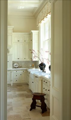 high ceilings ..cream cabinets
