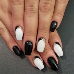 Black and White nail design with a little gold glitter.