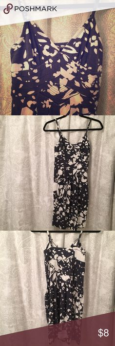 AE floral dress Unique whimsical dress with flowers and petals. The design is super cool though I'm not sure exactly how to describe it! Has elastic on the back and adjustable straps. Worn a few times, in very good condition.  bundle and save! American Eagle Outfitters Dresses