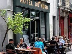 in front of the canal St Martin. girls are wonderful (30 years old) and white wine is good and not expensive (5 euros the glass of Chardonnay). It's also a restaurant. Hotel du Nord  102, quai de Jemmapes 75010 Paris