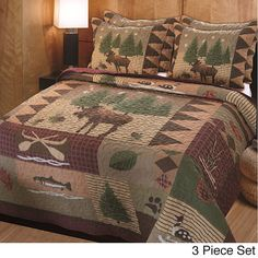 Add a bit of the great outdoors to any bedroom with this rustic quilt set. It features a pattern of moose, fish, and trees that will go great in the bedroom of a sportsman or in your cabin on the lake. It comes complete with a quilt and two shams.