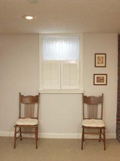 fake shutters under window to make it look longer