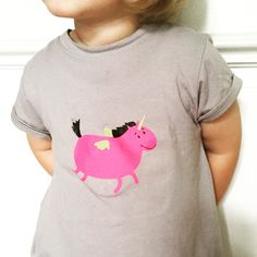 In unicorns she trusts.   Her favorite t-shirt from http://www.hugochodibos.cz
