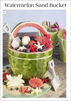 The perfect centerpiece for your beach themed party  Bucket full of edible seashells