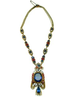 """1950's Hobe signed gold toned pendant necklace with red, blue, and crystal stones set in an ornate setting.  Pendant is detachable and can be worn as a pin. Necklaces measures 17 1/2"""" in length and the pedant measures 3"""" in length and 1 1/4"""" in width.     #HOLTaiganJewels"""