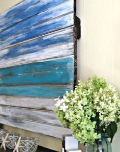 unframed canvas above mantle | old wood ocean wall art