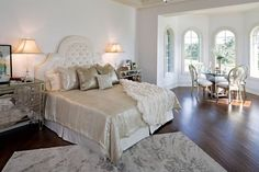 Indianapolis Monthly's 2012 Dream Home: An exclusive look inside the city's premier show home. A crisp color palette of mostly white-and-cream walls and furniture—with splashes of color throughout—complements the builder's architectural design. #bedroom #masterbedroom