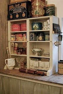 I love everything about this...the curtains for cabinet doors, the wood counter top, the shelf on the counter....I have to have this!