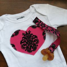 Like the idea of the simple applique with a matching binkie leash.