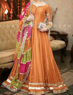Semi Casual dress designs for your assistance available at Baajo's only. Colours and sizes can be customized. Asian Bridal Dresses, Simple Pakistani Dresses, Pakistani Fashion Casual, Pakistani Wedding Outfits, Pakistani Dress Design, Long Gown Design, Fancy Dress Design, Girls Frock Design, Kurta Designs
