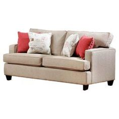 """Sofa in unique bisque with piped edging and exposed feet. Made in the USA.   Product: SofaConstruction Material: Polyester and high density foam coresColor: BisqueFeatures: Toss pillows includedDimensions: 36"""" H x 80"""" W x 36"""" D"""