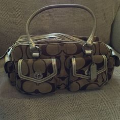 Coach signature handbag Large signature handbag with metallic gold accents. Good used condition. Coach Bags Shoulder Bags