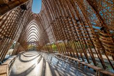 A pavilion of woven bamboo and steel by Zuo Studio arches over a body of water to create a shady place to sit in Huludun Park in Taiwan. Organic Architecture, Modern Architecture House, Commercial Architecture, Modern Buildings, Architecture Photo, Landscape Architecture, Architecture Quotes, Sustainable Building Materials, Bamboo Construction