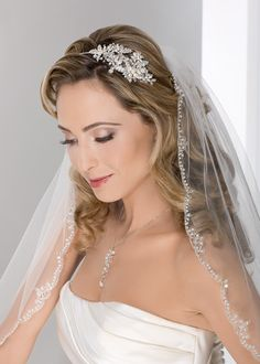Bel Aire Bridal 6277 on @Terry Costa - Delicate headband of pearl flowers and rhinestone leaves.