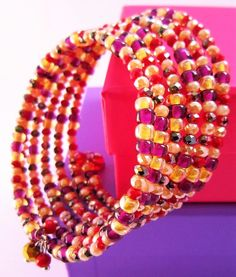 """This Gorgeous """"Sparkling"""" Wrap Bracelet is strung on stainless steel memory wire and it wraps around your wrist six times around the wrist in bursting colors of Raspberry, Champagne, Purple"""