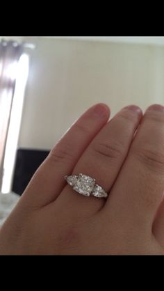 Claire's 1.93ct Cushion cut diamond is beautifully complimented by a pair of pear shaped diamonds and mounted in a custom designed setting... Gorgeous!